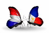 image of holland flag  - Two butterflies with flags on wings as symbol of relations Holland and Philippines - JPG