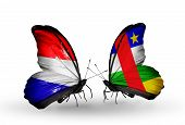 stock photo of holland flag  - Two butterflies with flags on wings as symbol of relations Holland and CAR - JPG