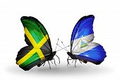 Two Butterflies With Flags On Wings As Symbol Of Relations Jamaica And Nicaragua