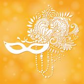 Carnival elements in white. Mask, feathers, beads, flowers. Yellow shimmering background