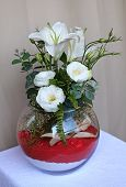 Beautiful bouquet of flowers in a round vase.