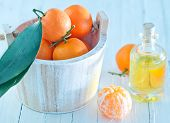 foto of essential oil  - Tangerine essential oil on the white table - JPG
