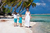 foto of deserted island  - Beautiful family of mother and two kids on a deserted island - JPG