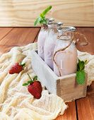 Strawberry Milkshake On A Rustic Wooden Table