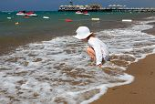 Little girl on sea beach.