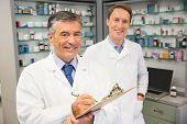 Senior pharmacist smiling at camera at the hospital pharmacy