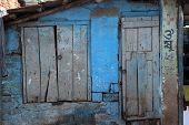 KOLKATA, INDIA - FEBRUARY 12: Colorful indian house. Bright blue building in Kolkata, West Bengal, India on February 12, 2014.