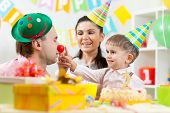 pic of indoor games  - happy family playing game on child birthday - JPG