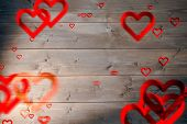 Love heart pattern against bleached wooden planks background