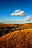 stock photo of steppes  - rural landscape steppe river and clouds on the sky background - JPG