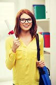 education concept - smiling redhead female student in eyeglasses with laptop bag and diploma