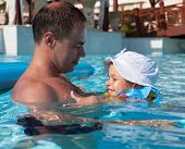 Dad with his daughter in the pool