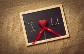 Toned Photo Of Heart In Declaration Of Love On Blackboard