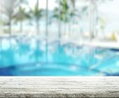 stock photo of spring break  - wood Table Top Background and Pool 3d render - JPG