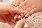 stock photo of acetone  - Nail Polish woman to a beautician beauty hands - JPG