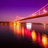 Illuminated footbridge at night on the Dnieper River Kiev Ukraine
