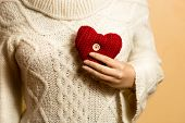 Photo Of Woman Posing With Red Knitted Heart On Chest