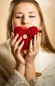 Portrait Of Woman Blowing Kiss And Red Heart