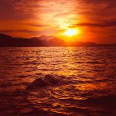 Beautiful golden sunset above the sea and mountain