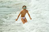 boy playing at the sea