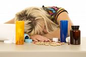 Woman Head Down With Lots Of Pills