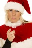 Woman In Black Shirt And Santa Hat Pointing