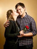 Beautiful Smiling Woman Kissing In Cheek Handsome Boyfriend