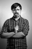 Monochrome Portrait Of Hipster Guy Posing With Fake Mustache