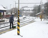 Woman Clears Snow From A Platform On Station
