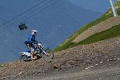 SOCHI, RUSSIA -?? AUGUST 16, 2014: Off-road motorcycle rider trains in summer mountains