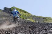 SOCHI, RUSSIA - AUGUST 16, 2014: Off-road motorcycle rider trains in summer mountains