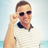 Smiling Caucasian Man Standing With White Sunglasses