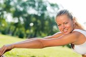 attractive woman of exercises on the grass