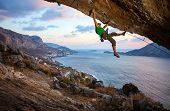 Male climber climbing overhanging rock