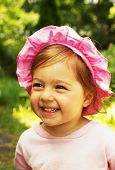 Portrait of cute little baby girl laughing