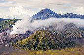 foto of bromo  - Smoke rises from the crater of bromo volcano in  java - JPG