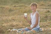 Smiling young farmer during break in field