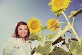 Vintage Happy Asian Woman In Sunflower Flower Field.