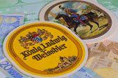 Beermats From Konig Ludwig Beer And Eur Banknotes..