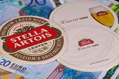 Beermats From Stella Artois And Eur Banknotes.