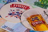 Beermats From Zywiec Beer And Eur Money.