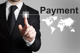 picture of payment methods  - businessman in black suit pushing button payment international service - JPG
