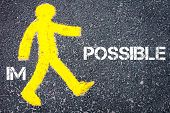 image of impossible  - Yellow pedestrian figure on the road walking towards POSSIBLE from IMPOSSIBLE - JPG