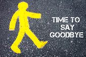 image of goodbye  - Yellow pedestrian figure on the road walking towards Time To Say Goodbye - JPG