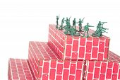 picture of top-gun  - Green army men guarding the top of red cardboard brick base - JPG