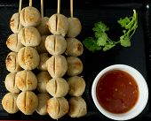 picture of meatball  - Food and Cuisine Delicious Grilled Meatballs on Wooden Skewer Served with Spicy Sauce and Green Coriander - JPG