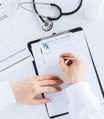 pic of prescription  - close up of male doctor writing prescription paper - JPG