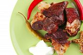 Roast Meat Chunks On Green Plate