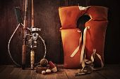 stock photo of life-boat  - Vintage still life fishing poles and life jacket - JPG
