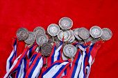 stock photo of medal  - Many bronze medals with tricolor ribbons close - JPG